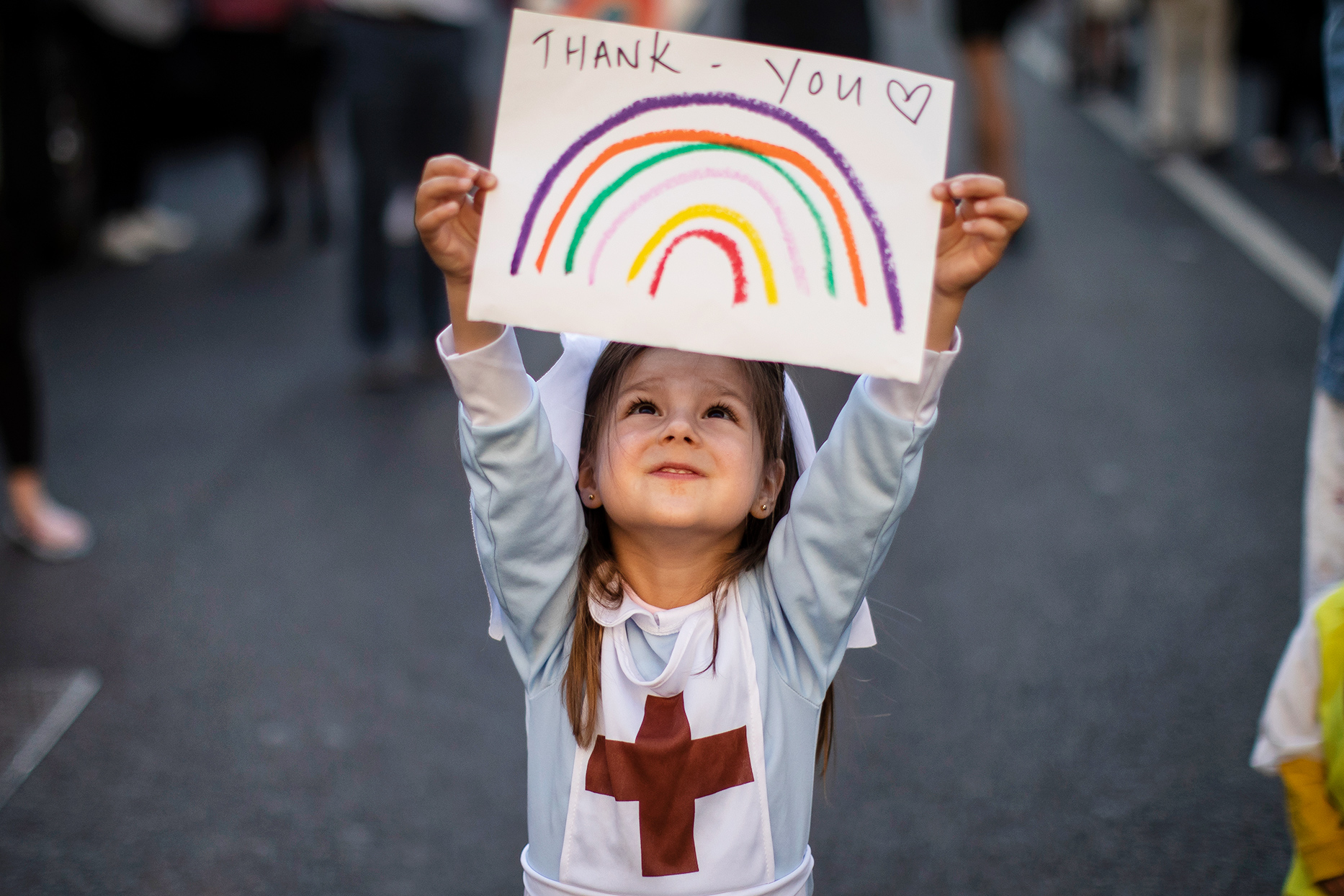 girl holding sign that says thank you