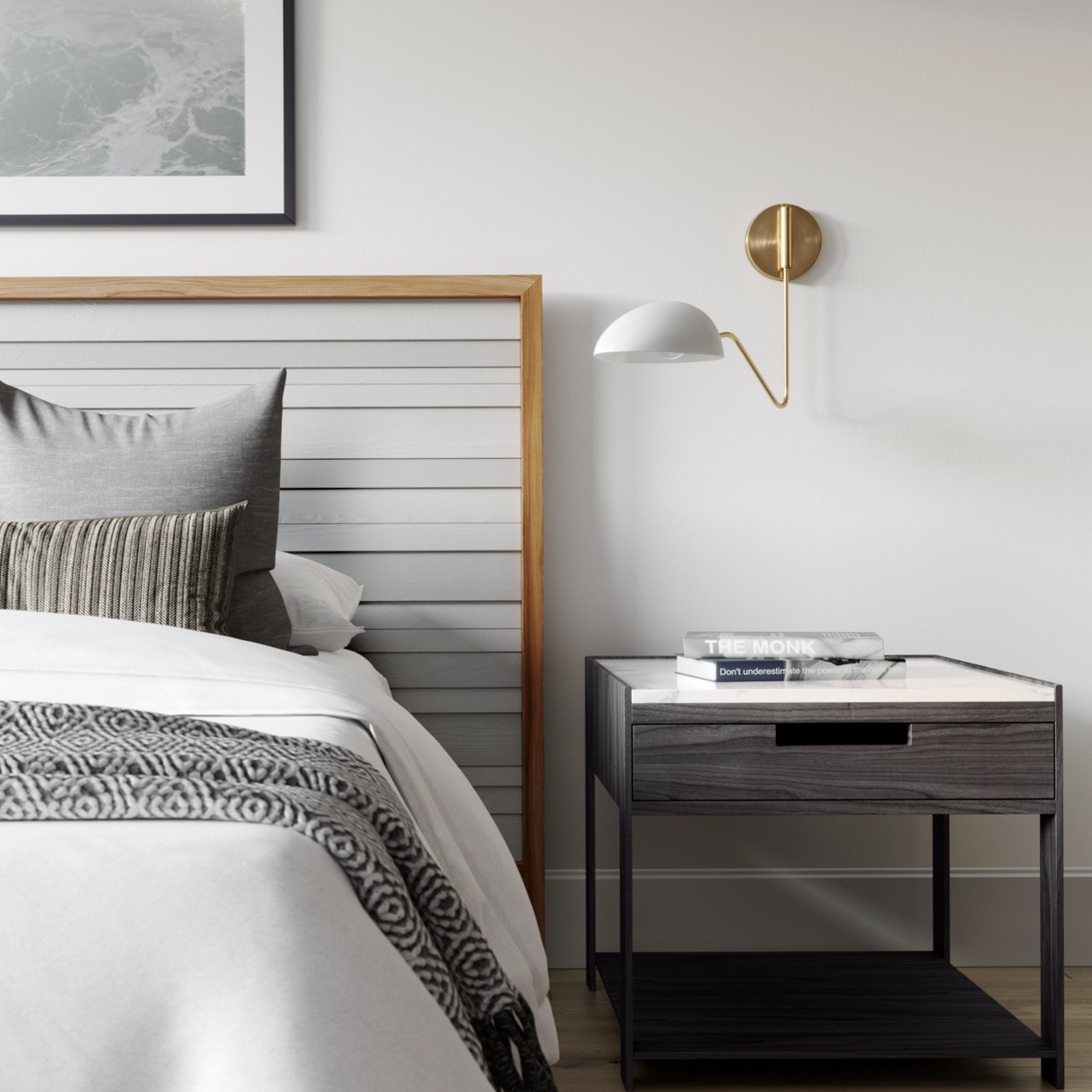 bedroom nightstand with light on wall