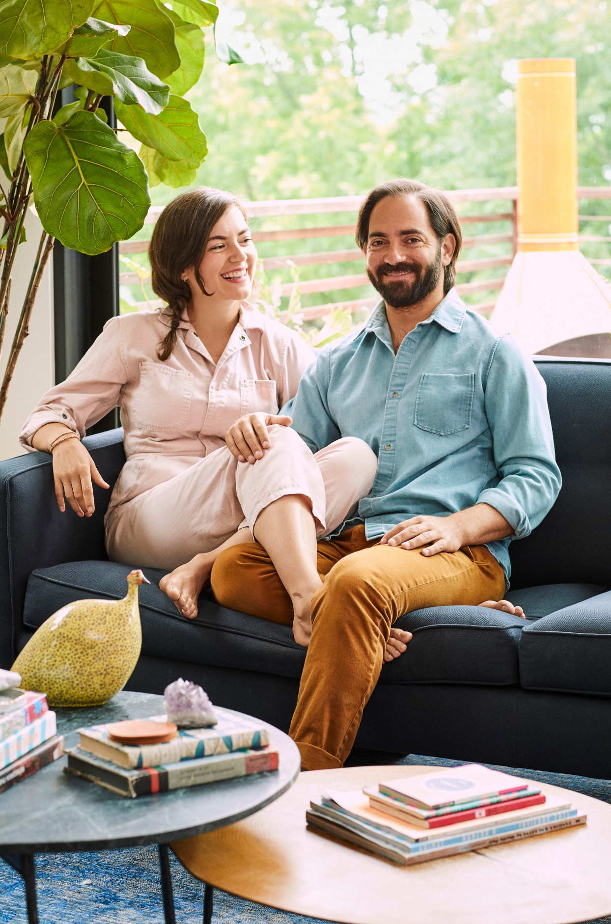 couple sitting together smiling on couch