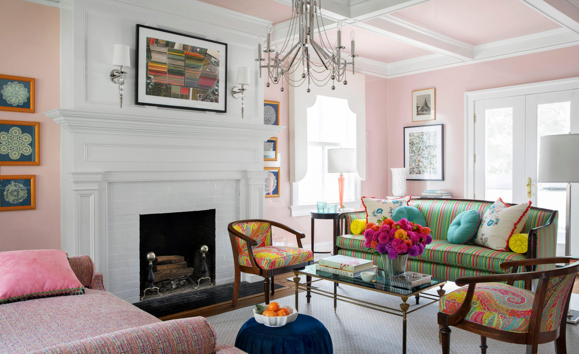 sitting room with pink walls and colorful furniture