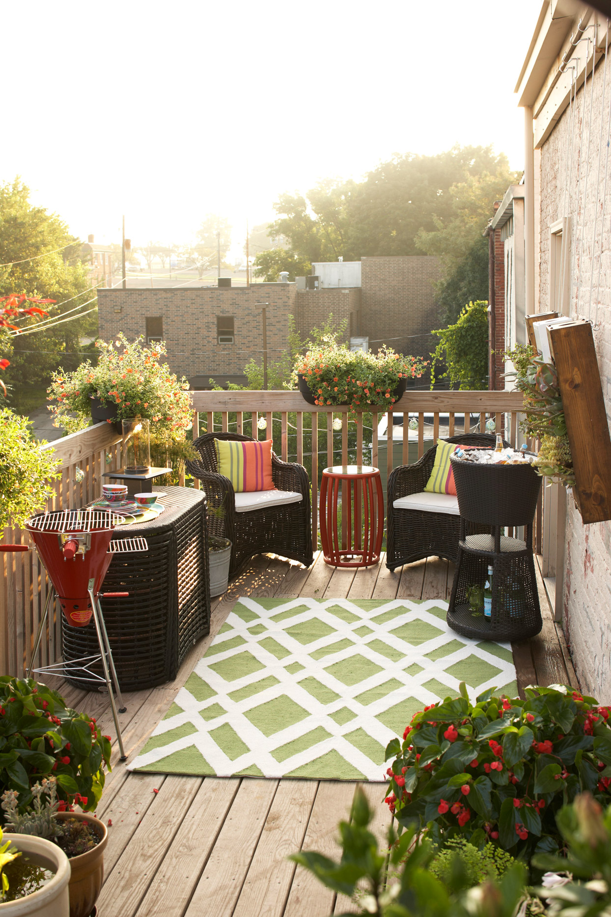 side view of small deck with black wicker furniture