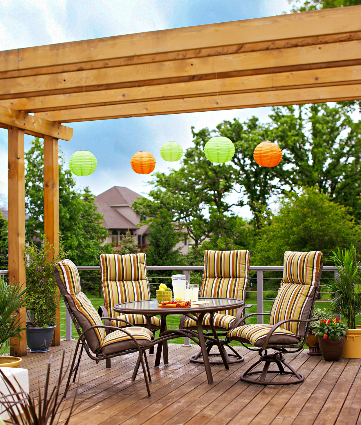 deck table chairs pergola hanging lights