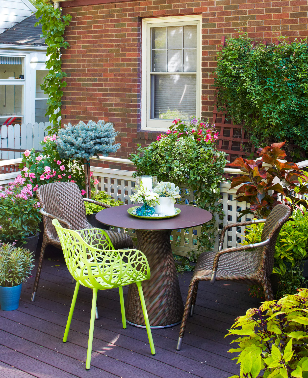 deck table chairs potted plants