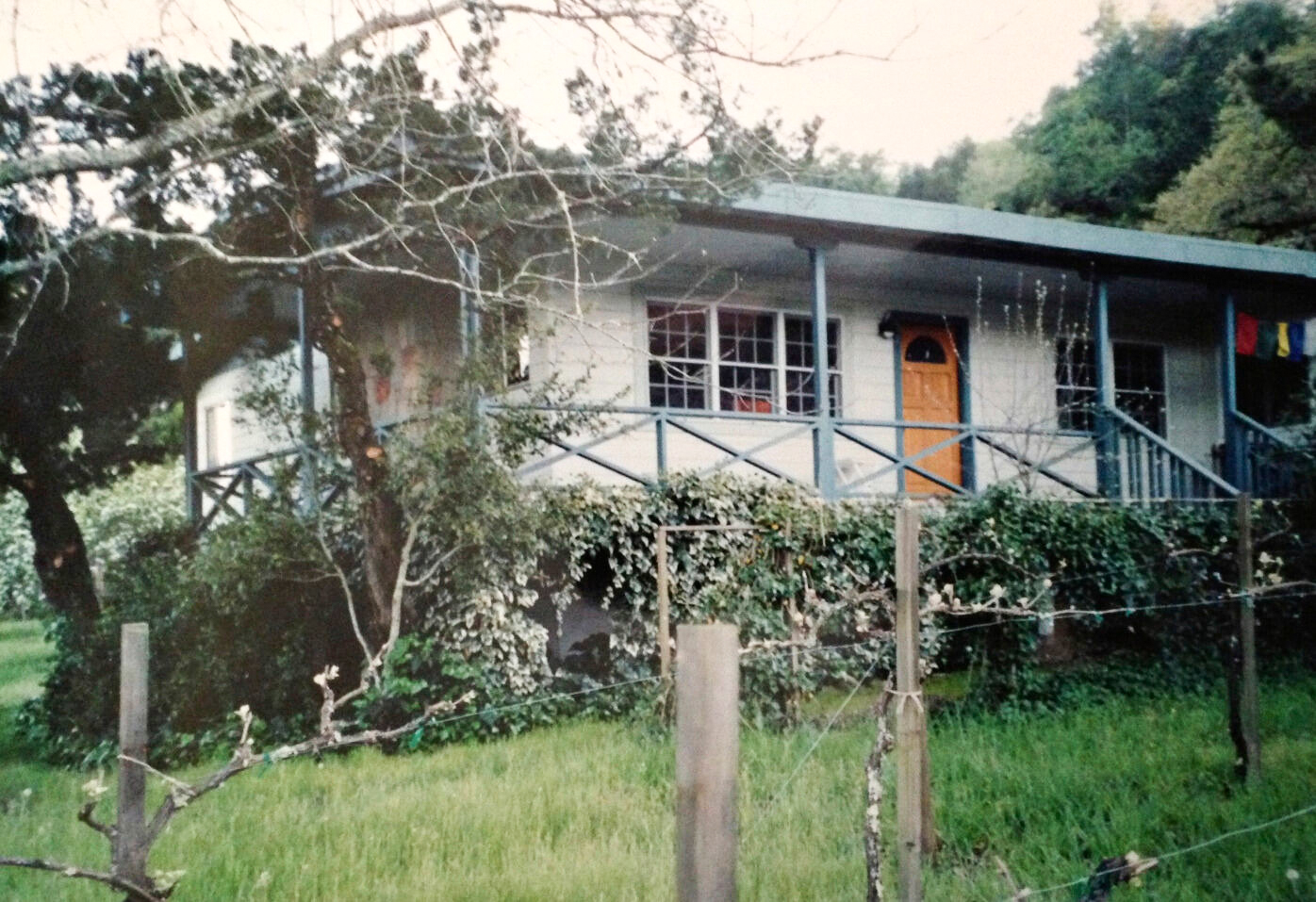 gray house with blue porch