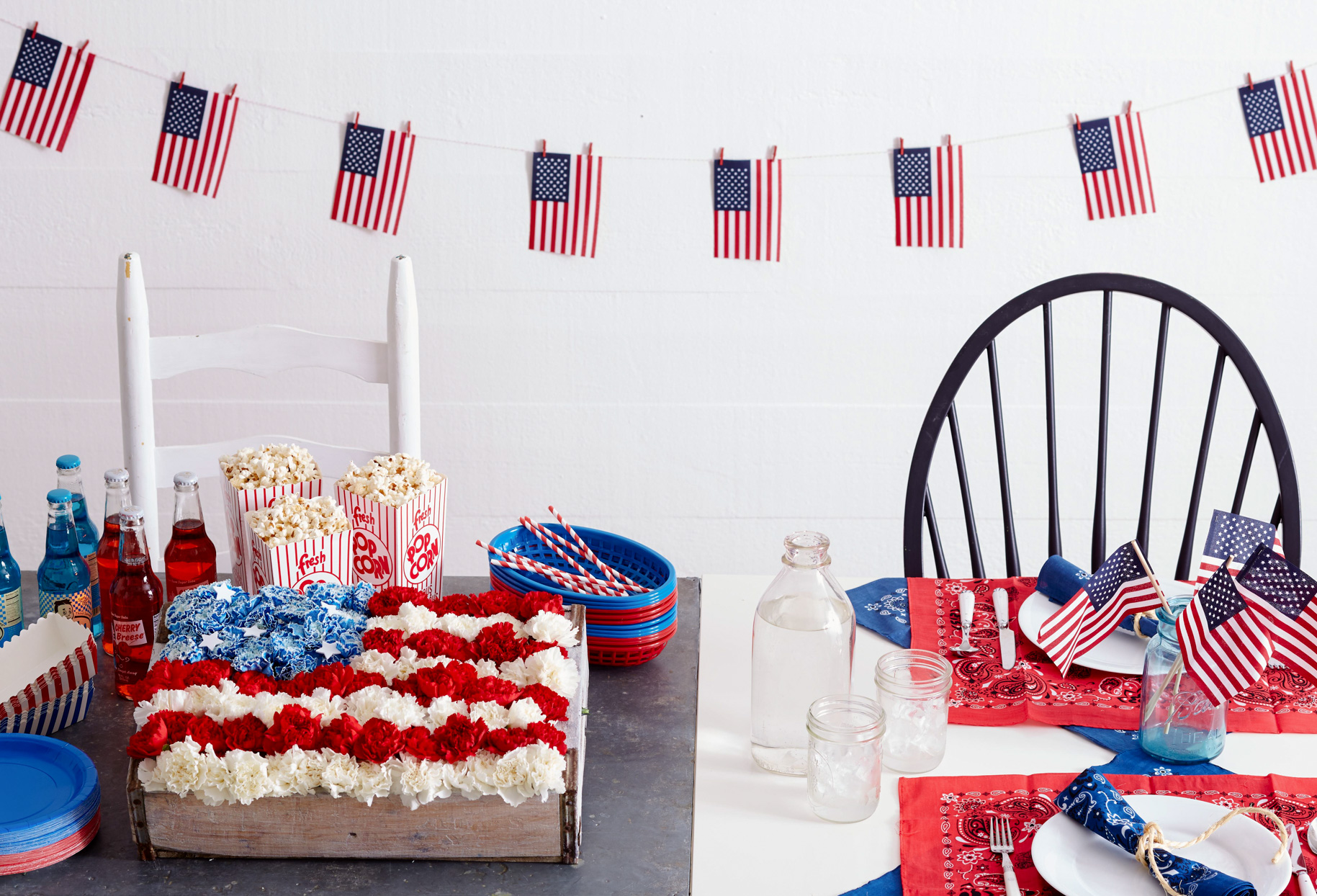 patriotic table with flag banner and place settings