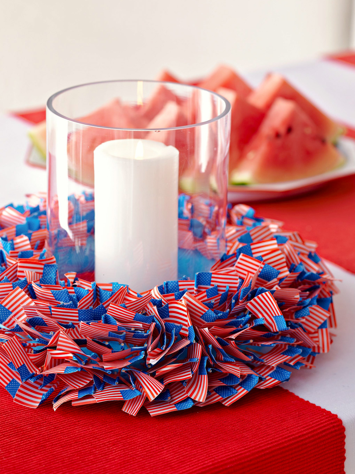 tiny flag centerpiece with vase and candle inside