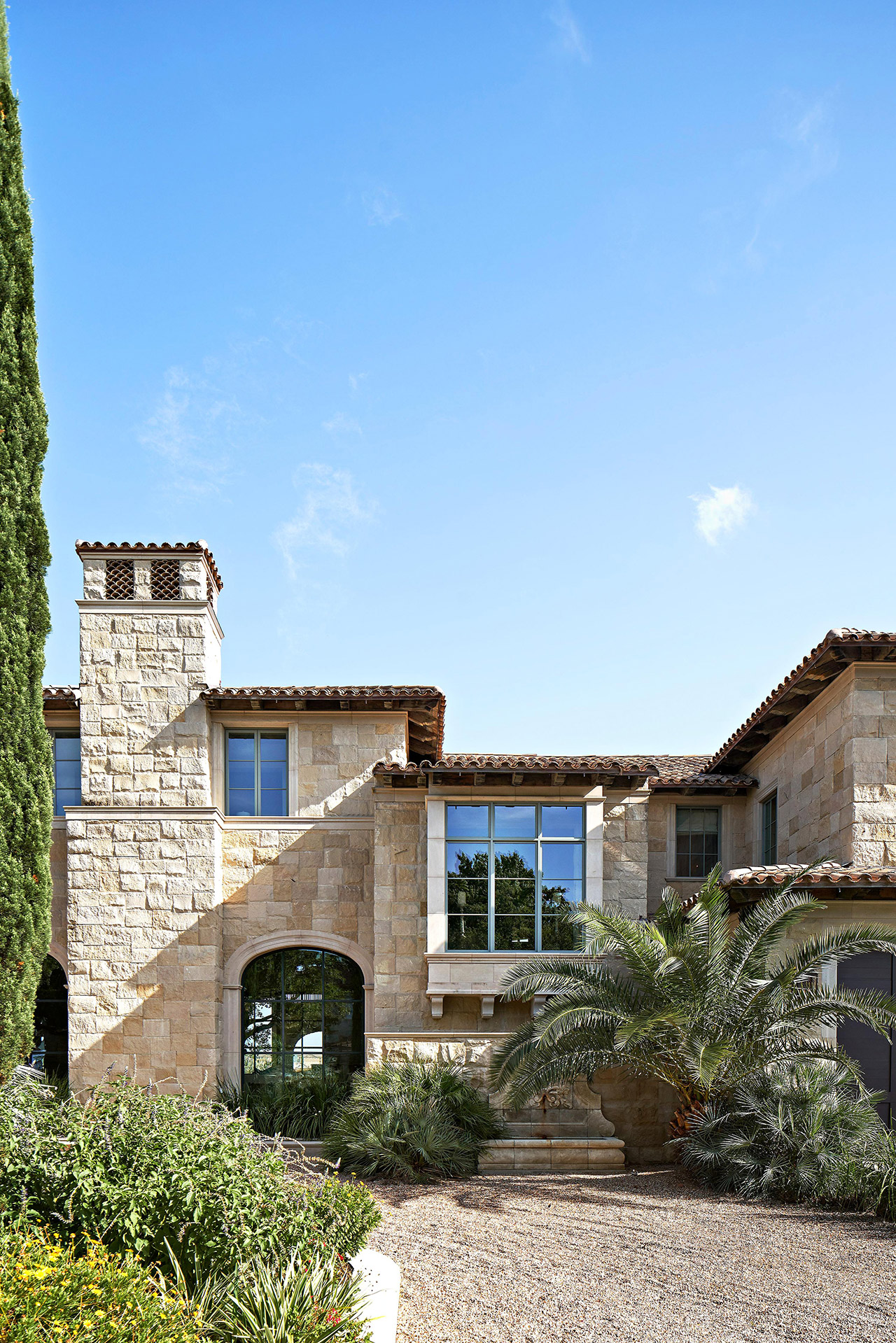 exterior stone house driveway tile roof