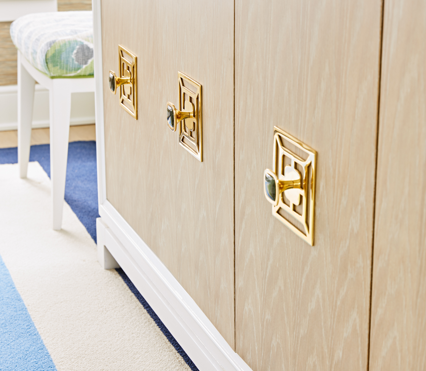 traditional gold geometric pulls green stone cabinet