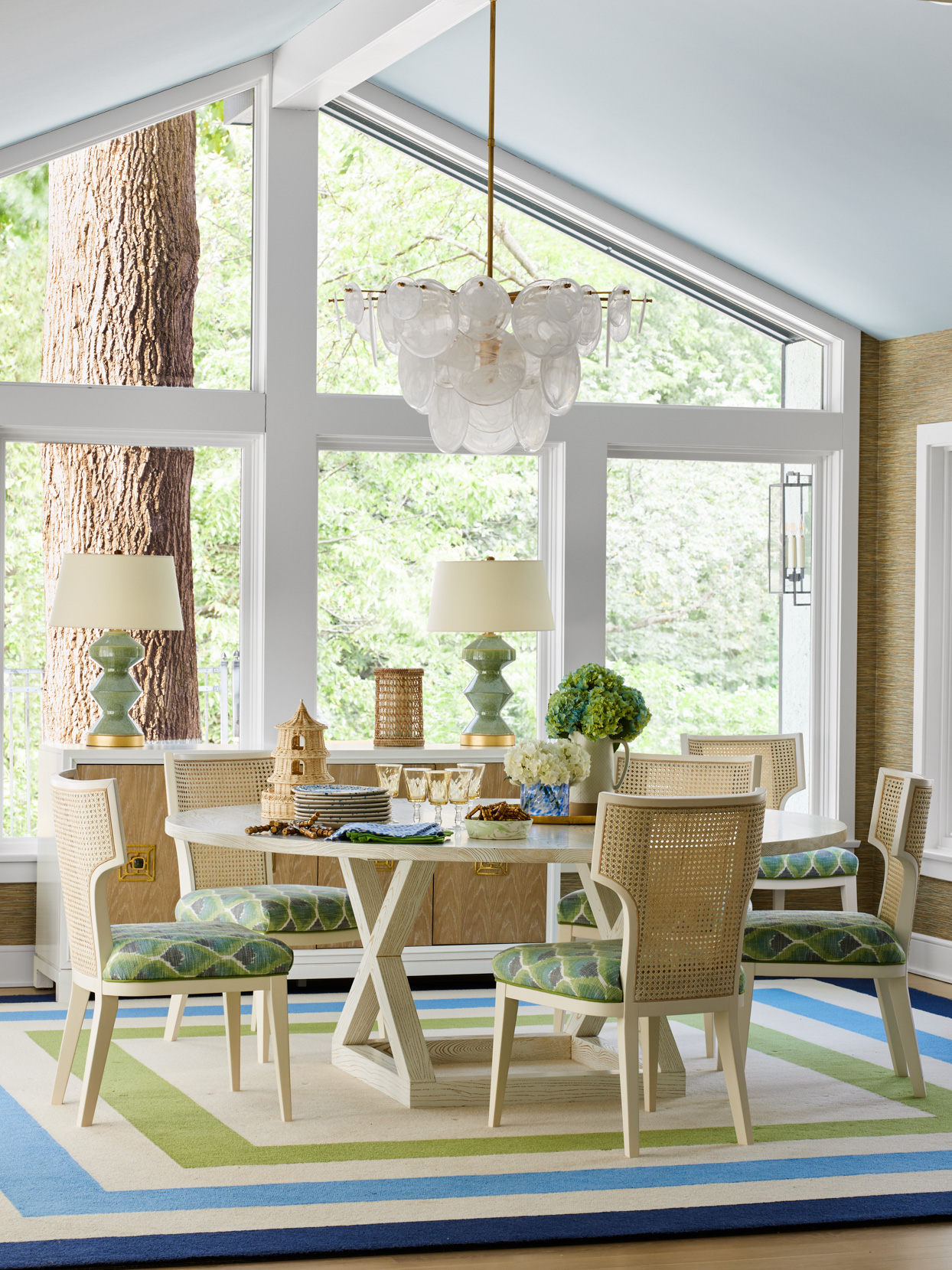 green and blue stripped area rug dinning area