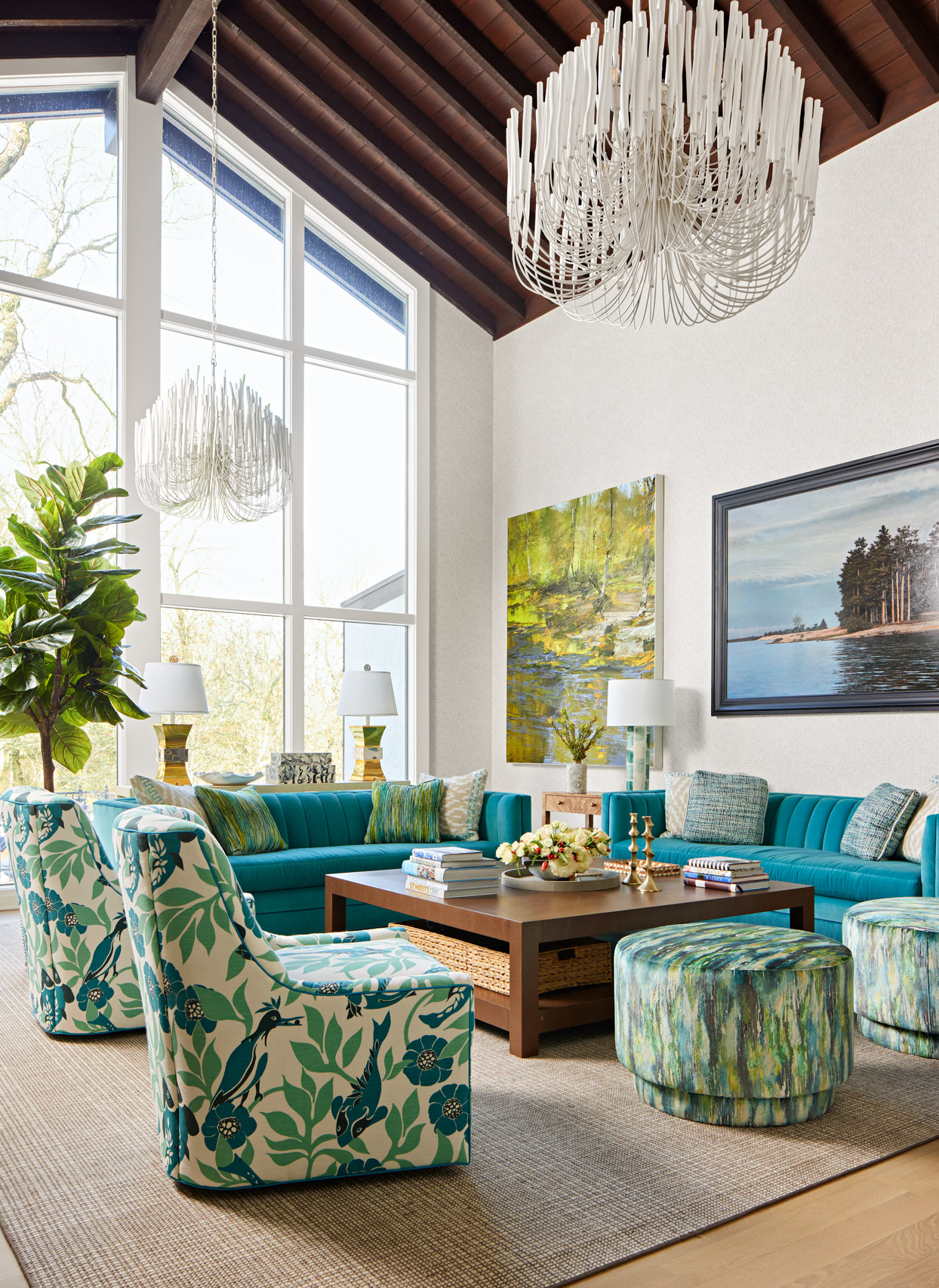 printed green accent chairs with teal couches