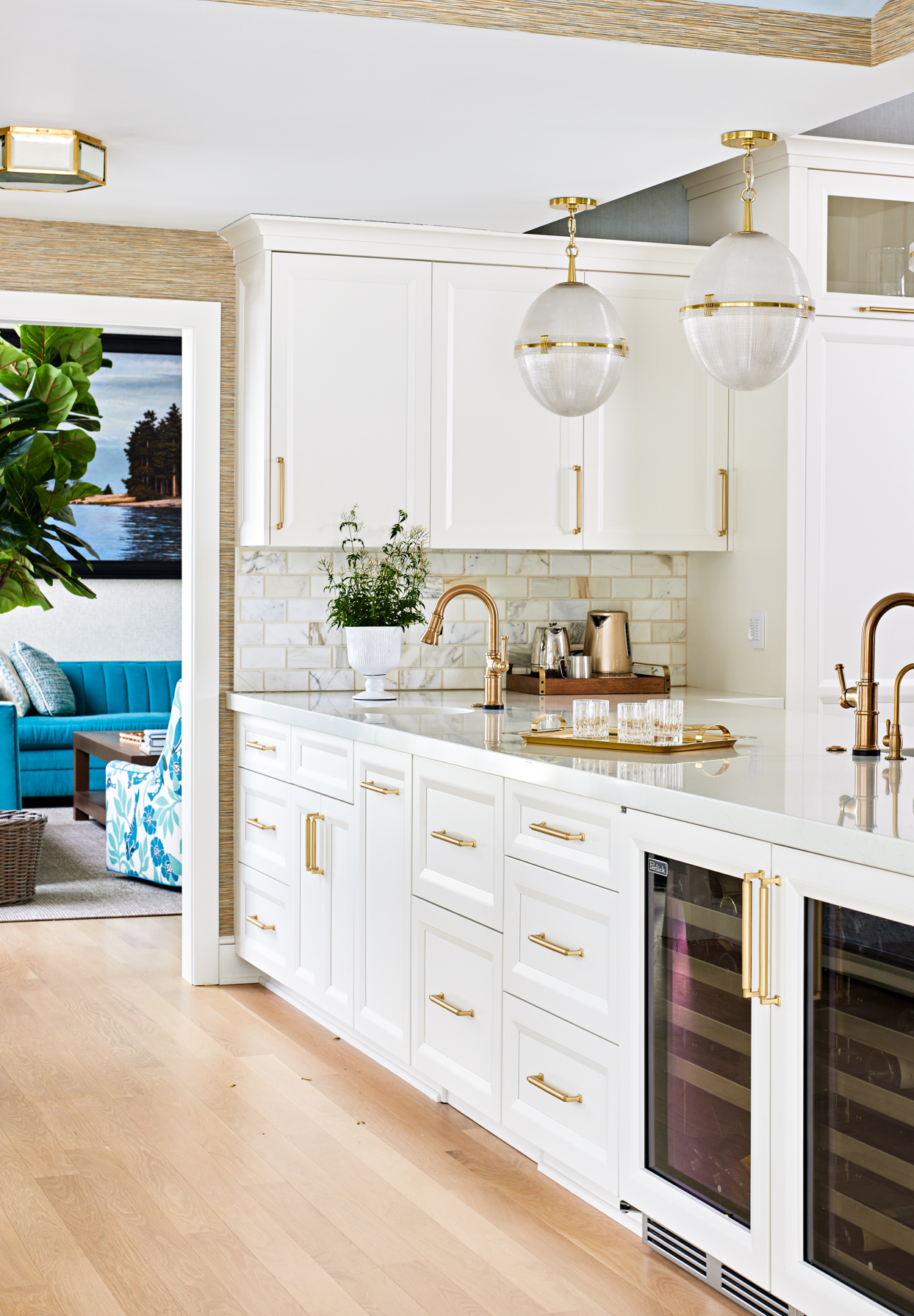 white kitchen cabinets with gold pulls and knobs