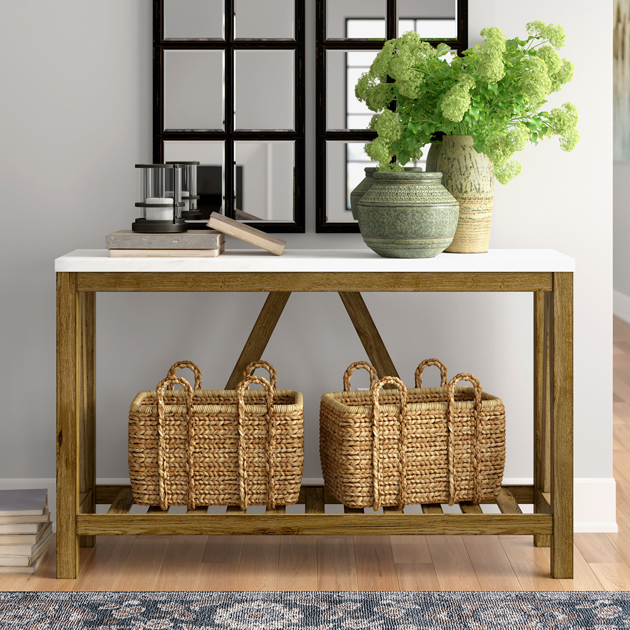 wood and marble console table with baskets and decor on top