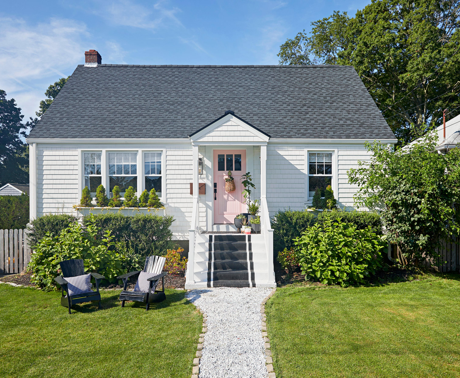 exterior white cape cod black painted front steps pink door