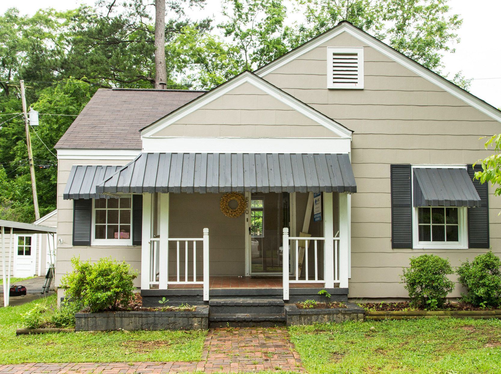 beige house gray awning