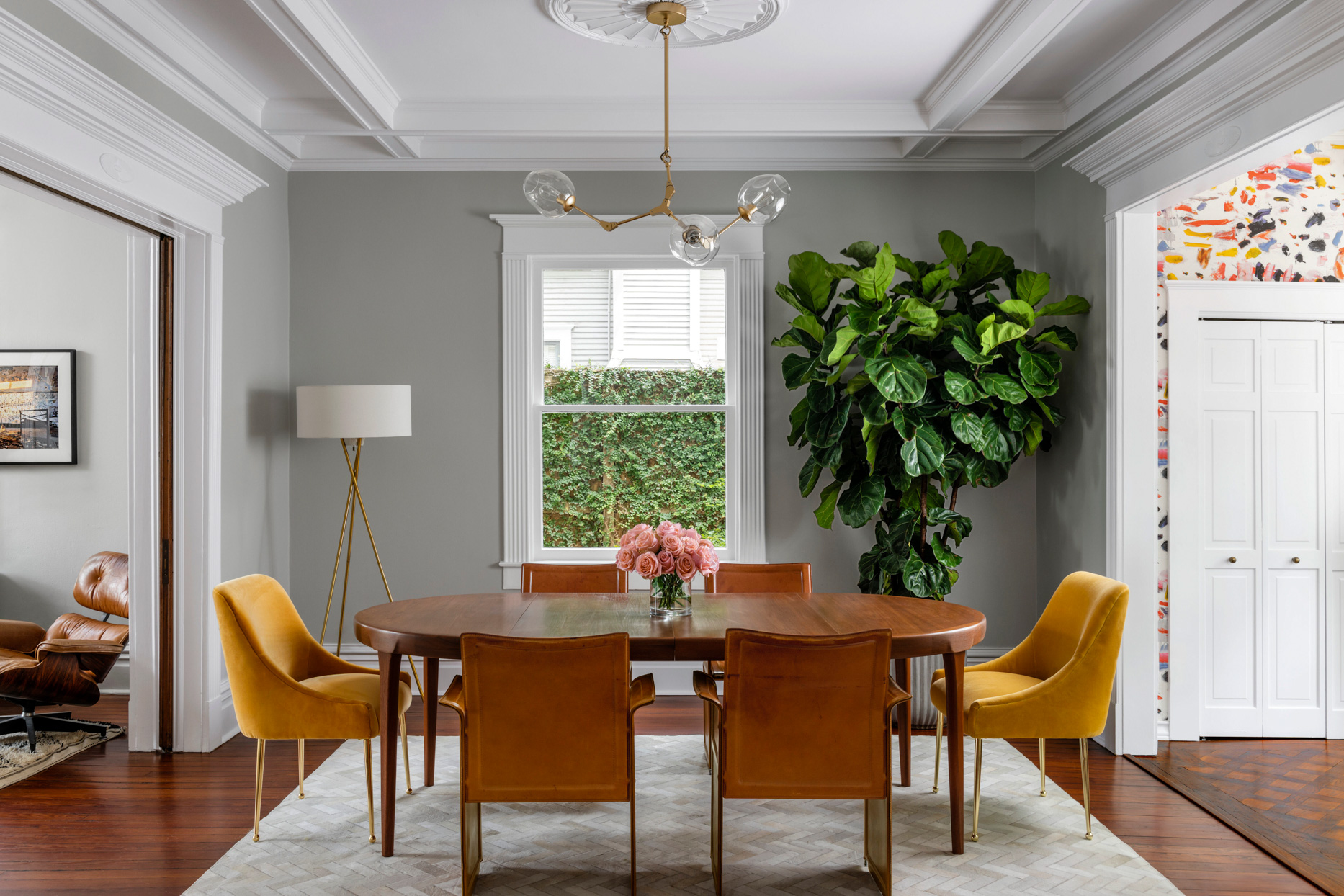 dining room with gray walls, white ceiling, and warm wooden table