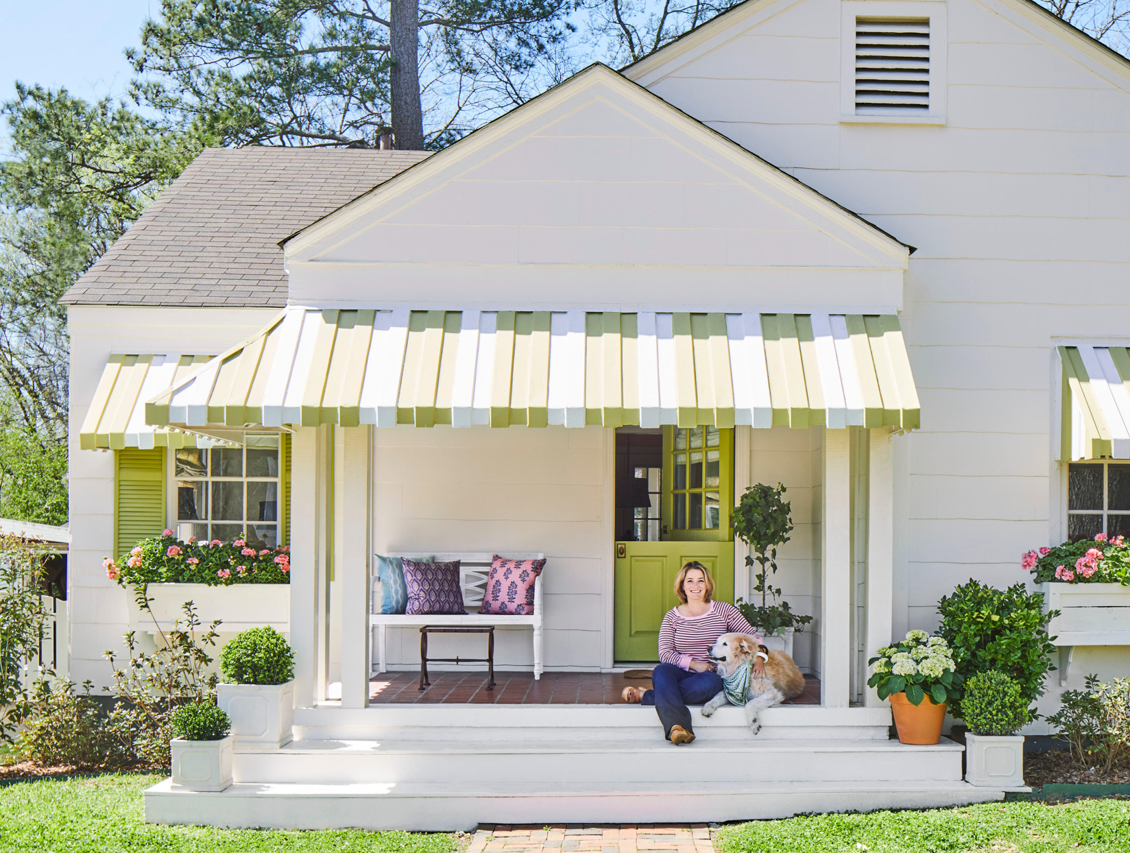 white house green white striped awning
