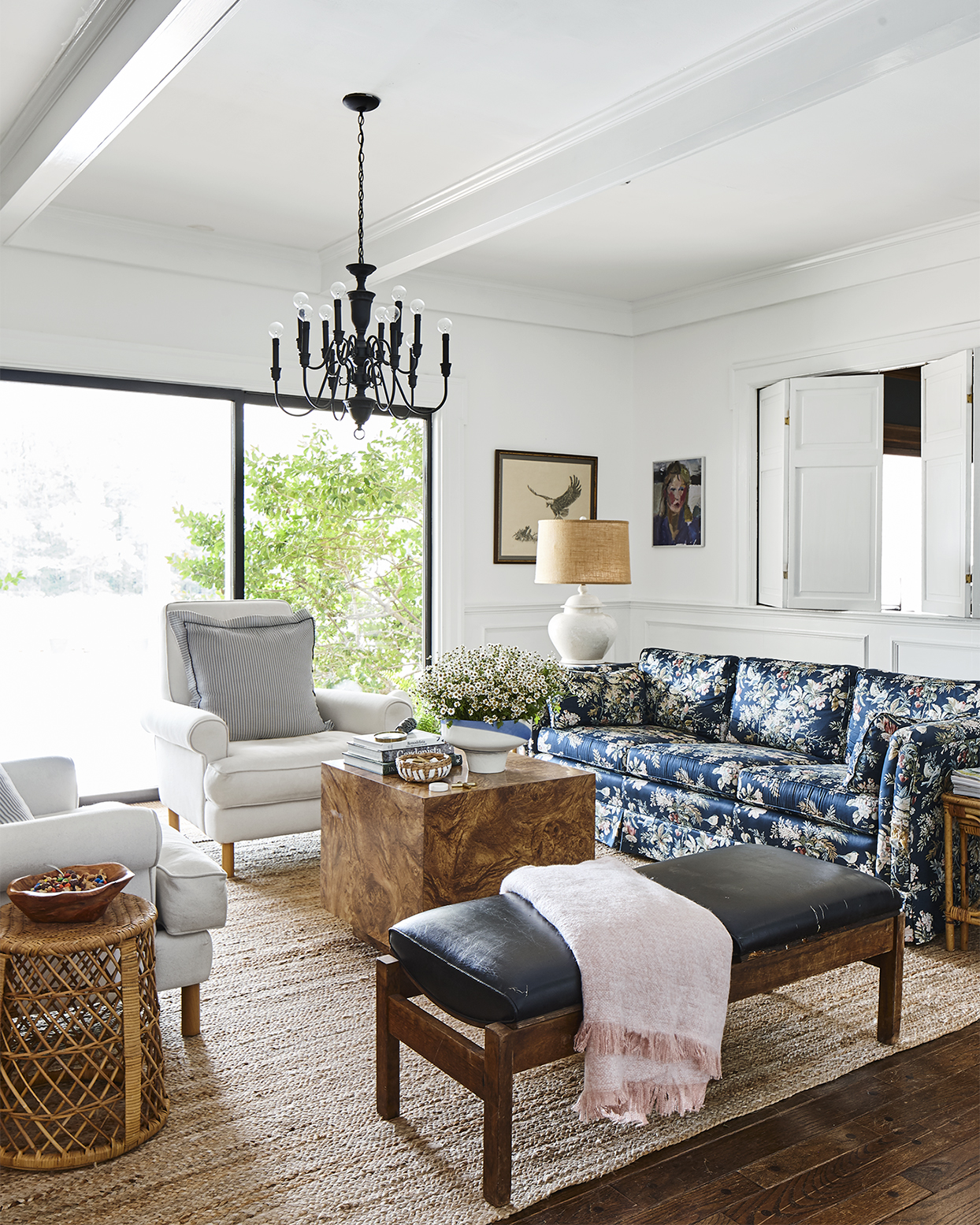 living room with floral sofa and burl wood coffee table