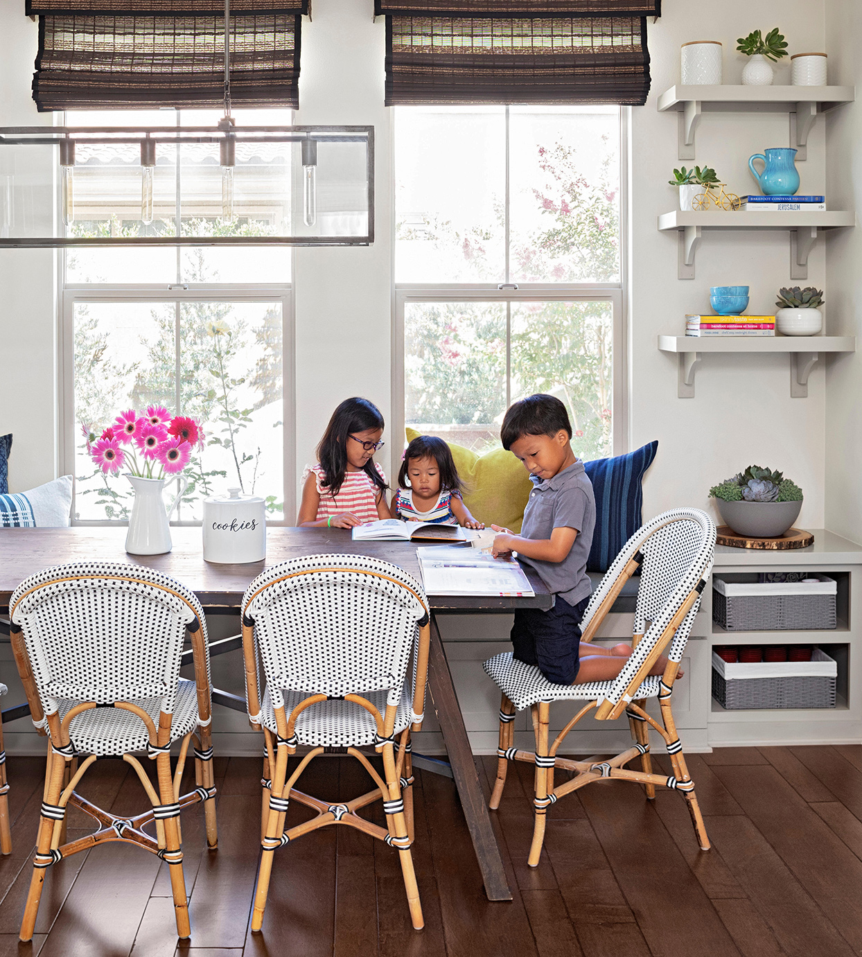 three young children dining table chairs banquette books