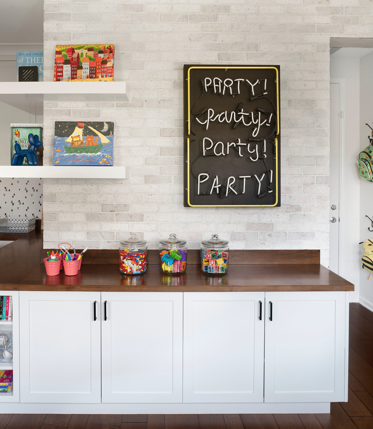 neon party sign playroom open shelving counter space jars