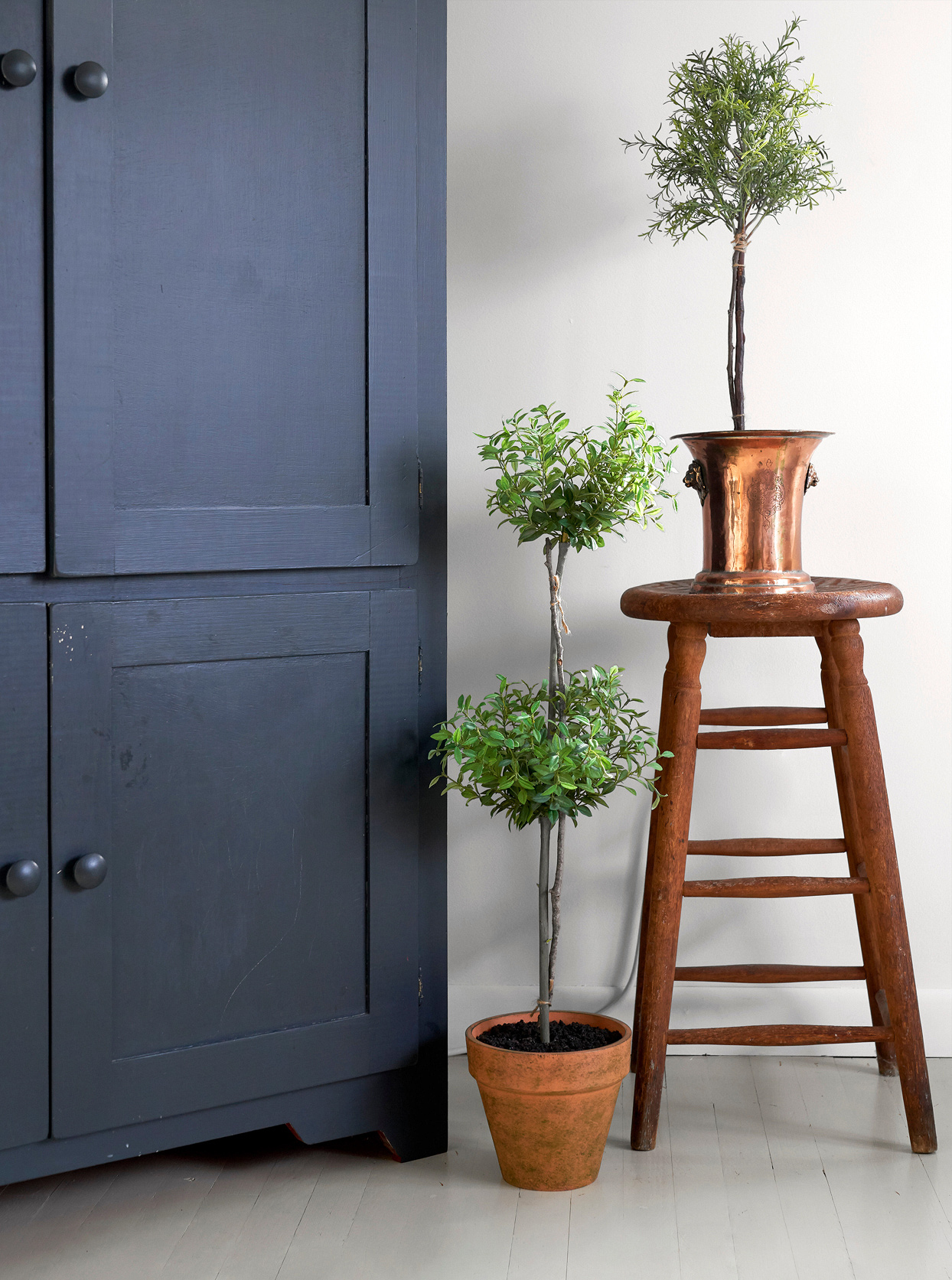blue-black rustic tv cabinet stool potted plants