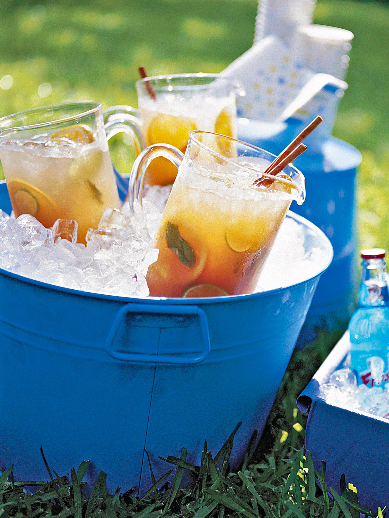 Chai Punch in pitchers in big blue tub