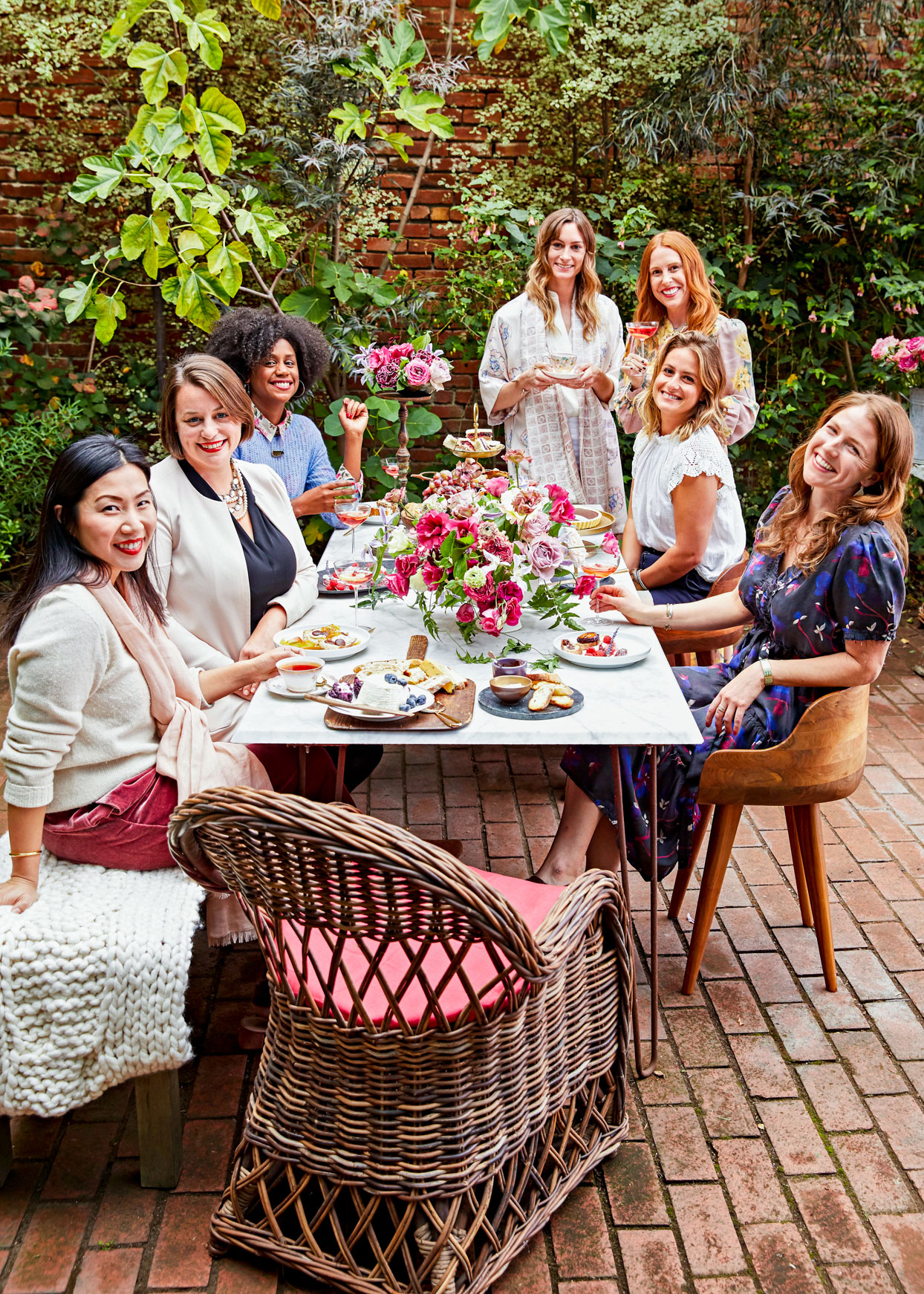 women at garden party at table