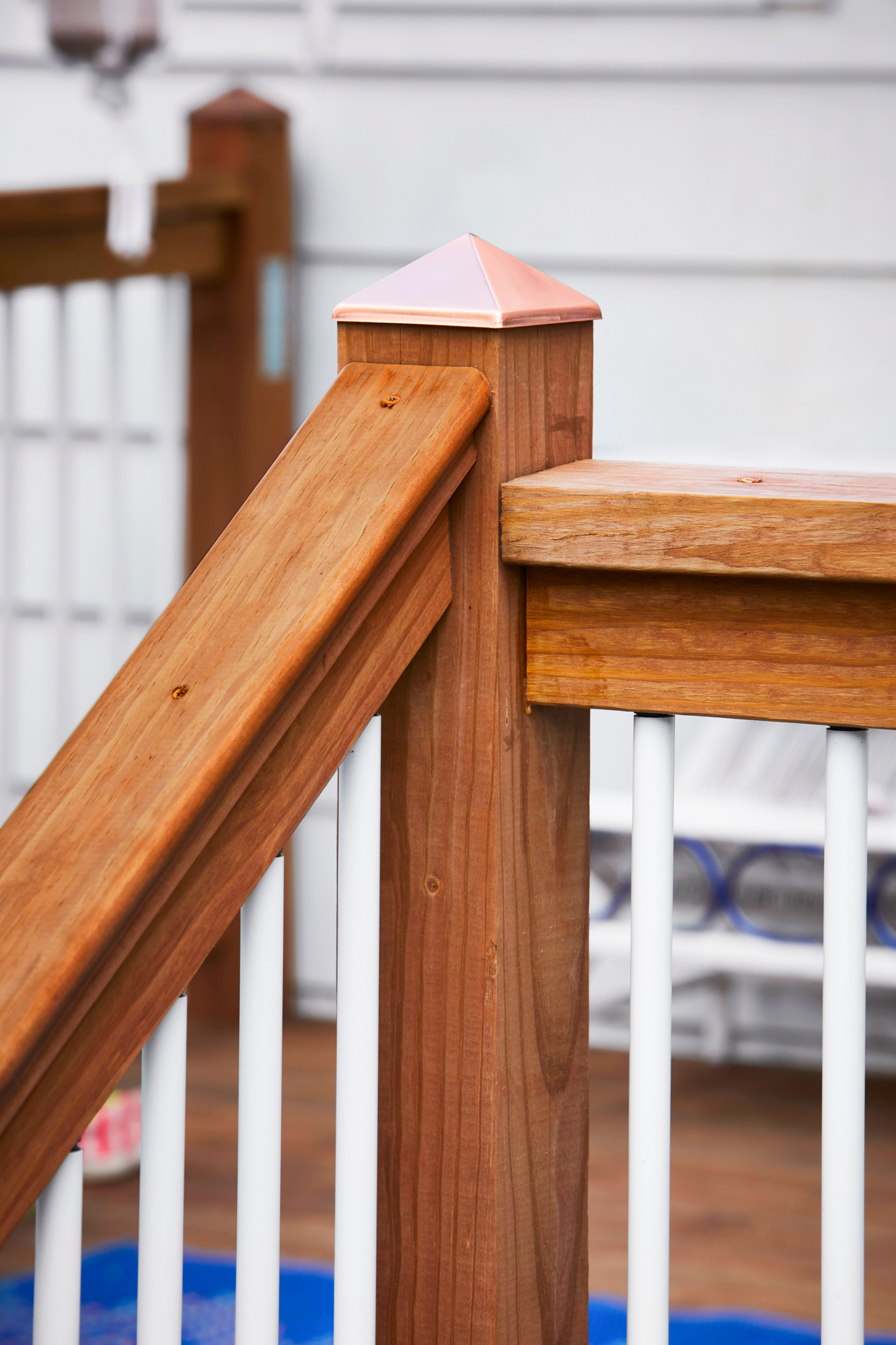 corner of stair railing on wooden porch