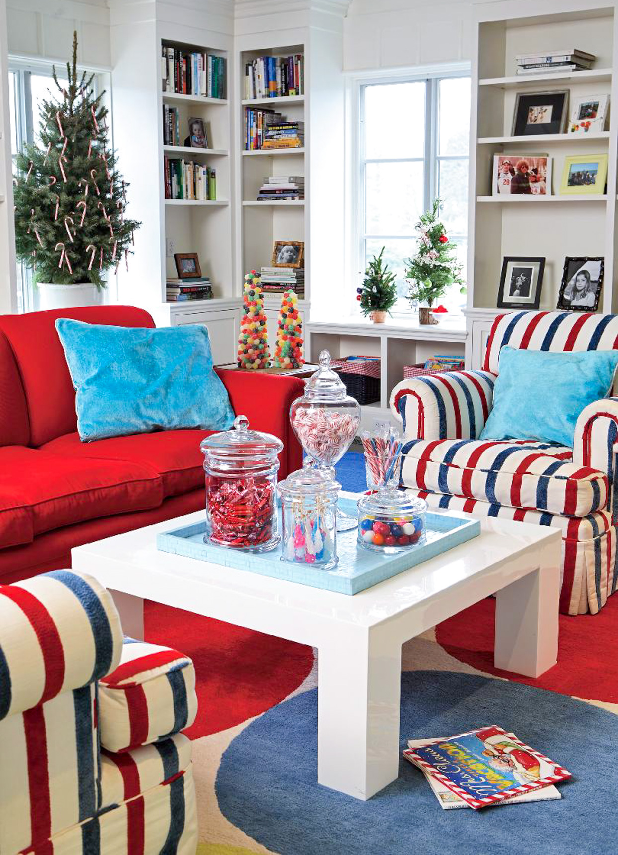 Living room with striped chairs and small Christmas trees