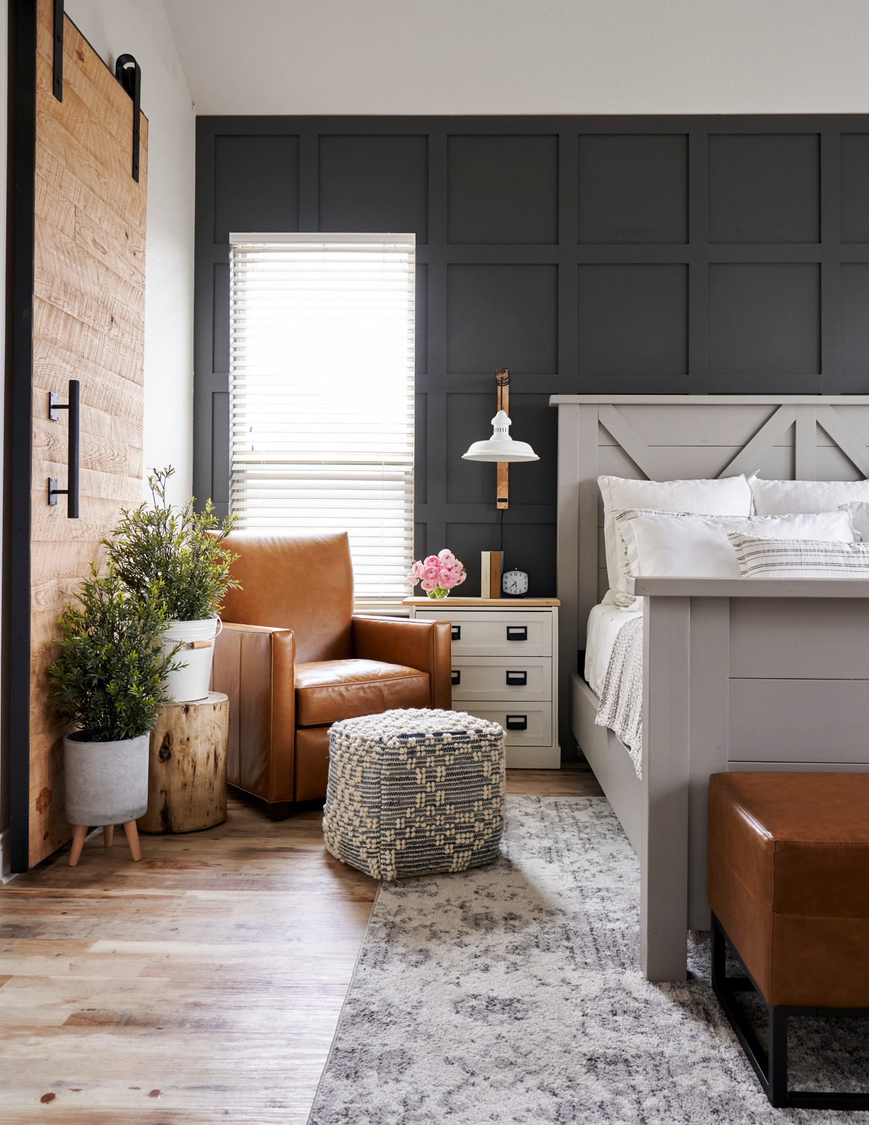 bedroom with wooden floors and black walls