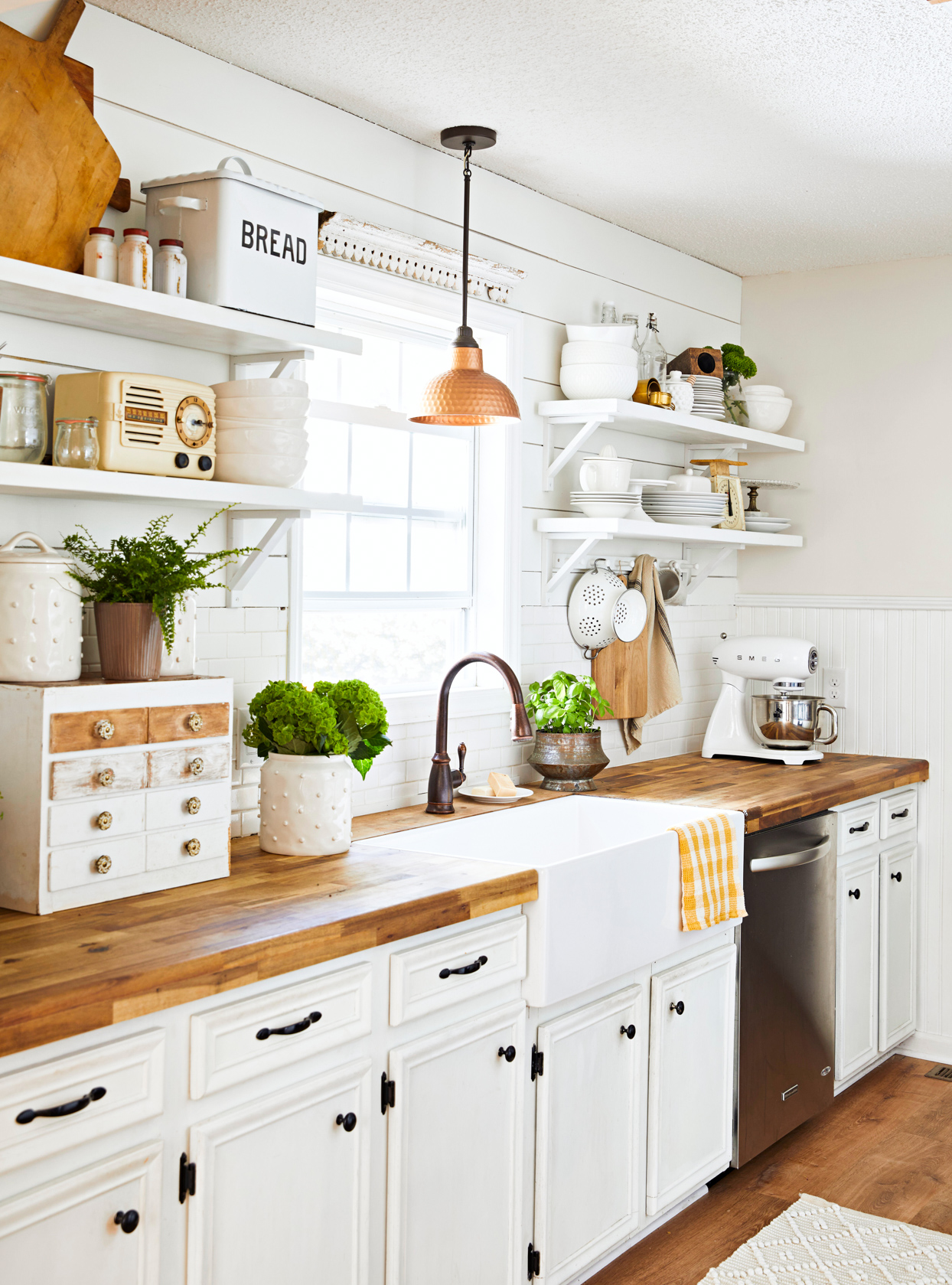 kitchen with white cabinets with wood top