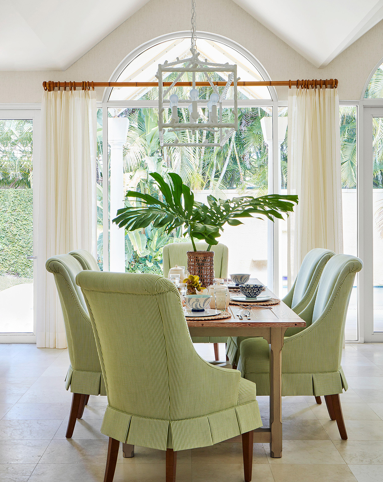 green lush tropical dining room monstera cuttings