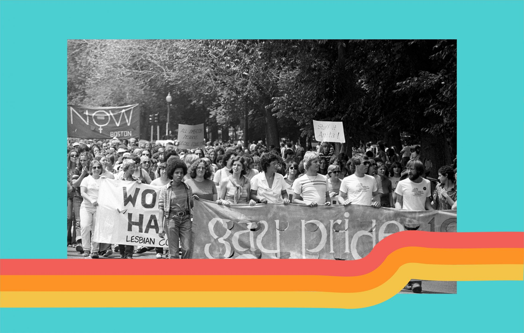 View of the large crowd, some of whom are holding up handmade signs and banners, participating in a gay and lesbian pride parade in the Back Bay neighborhood of Boston, 1975