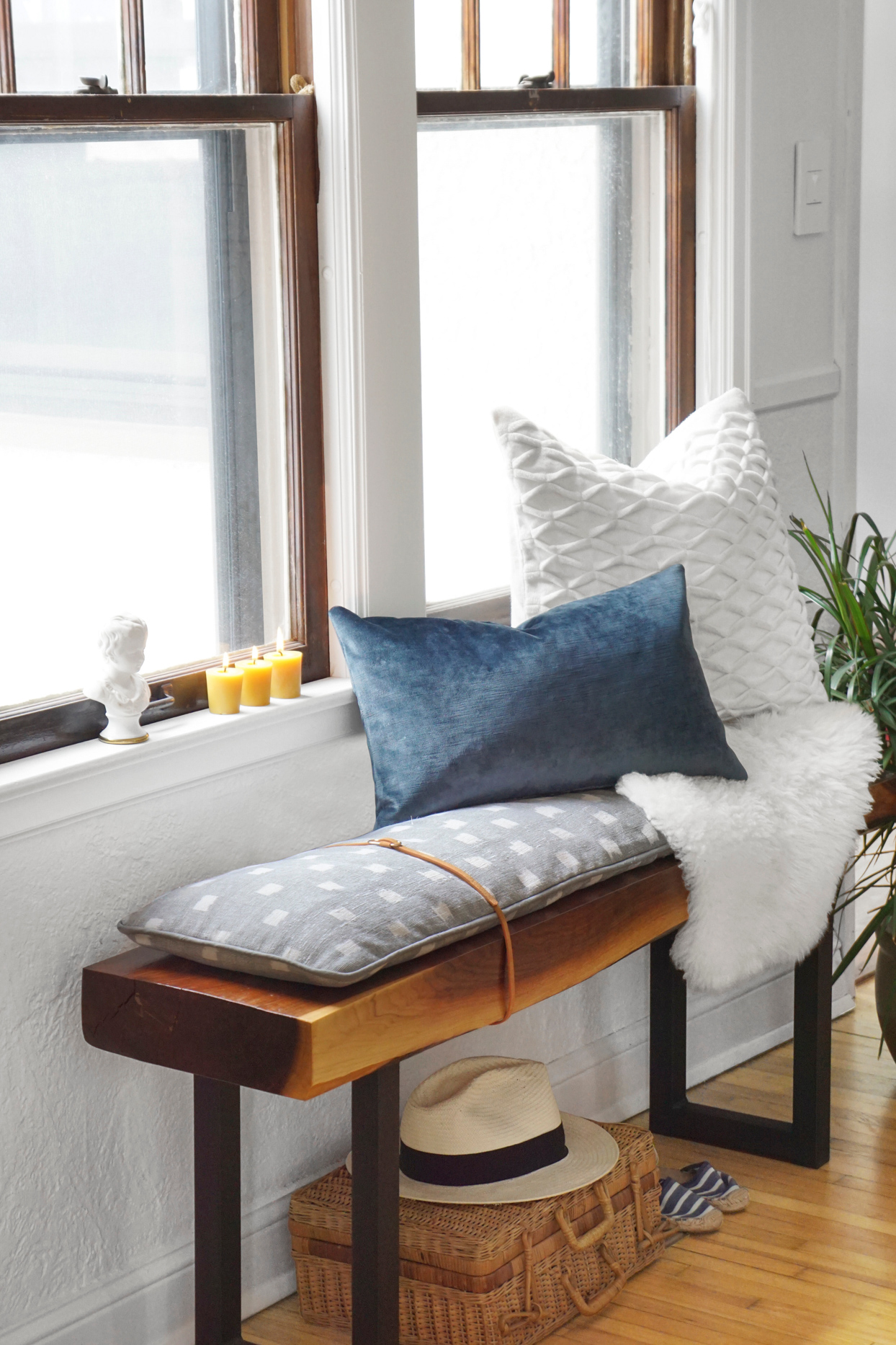 bench with cushion underneath windows pillows