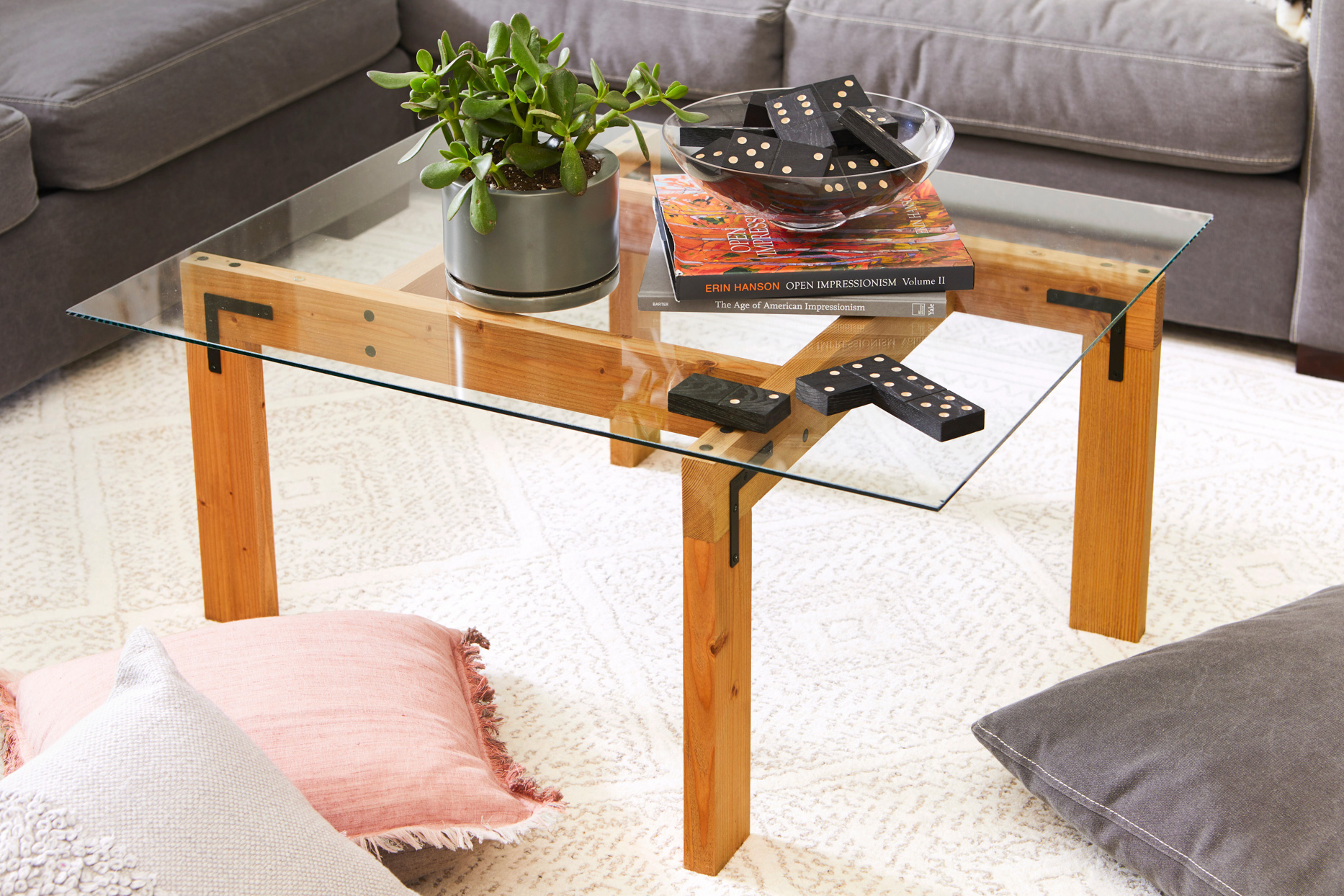 craftsman wooden legs glass-topped table