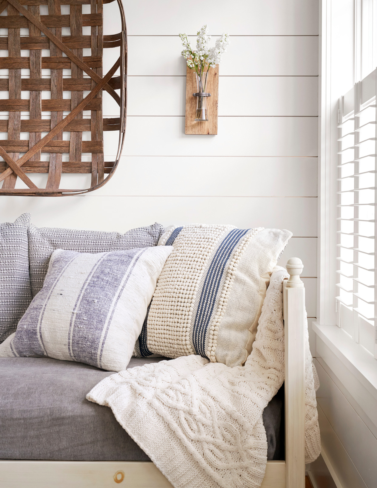 white wooden couch light purple cushions