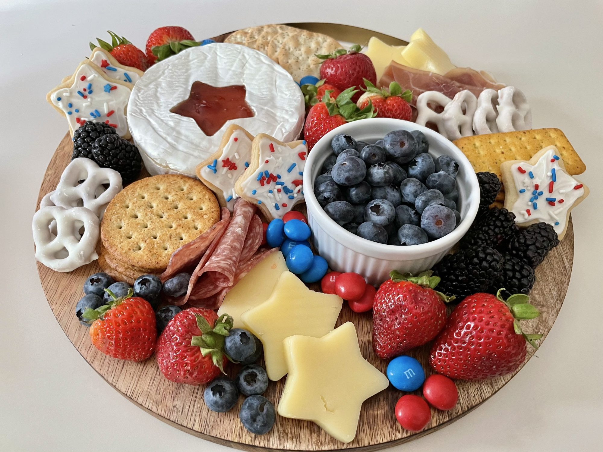 charcuterie board with red and blue food