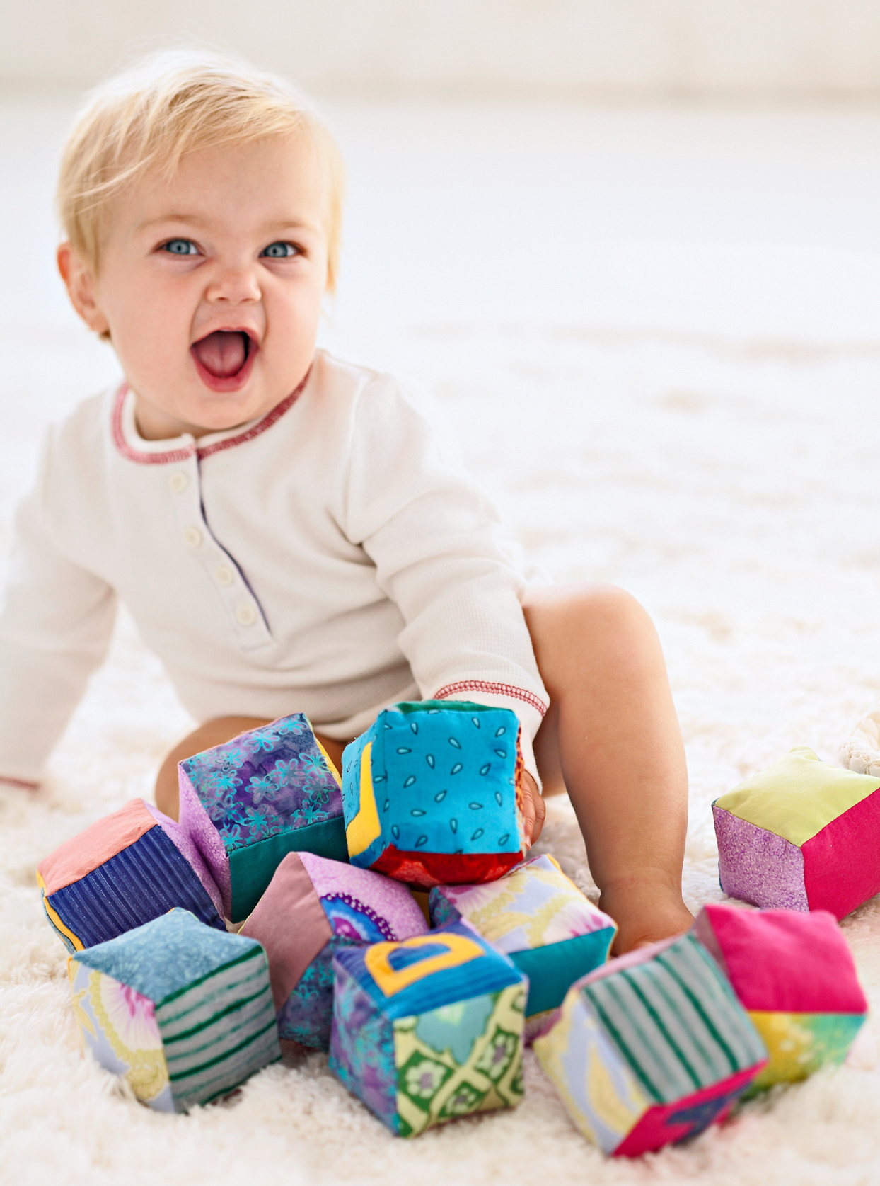 happy baby with colorful blocks