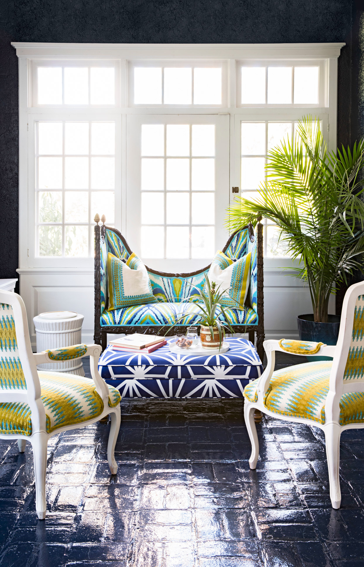 sitting area with colorful patterned chairs