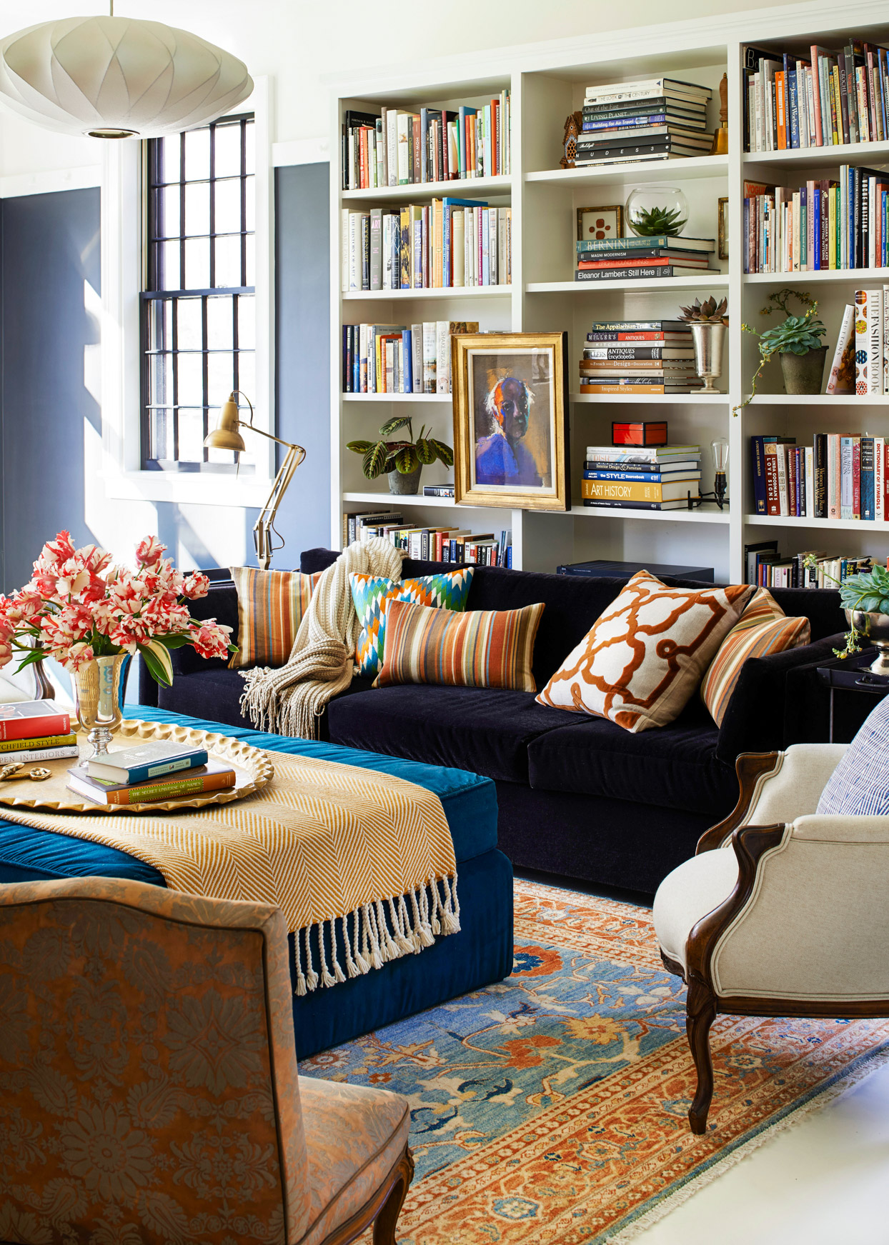 navy painted wall bookshelf black couch