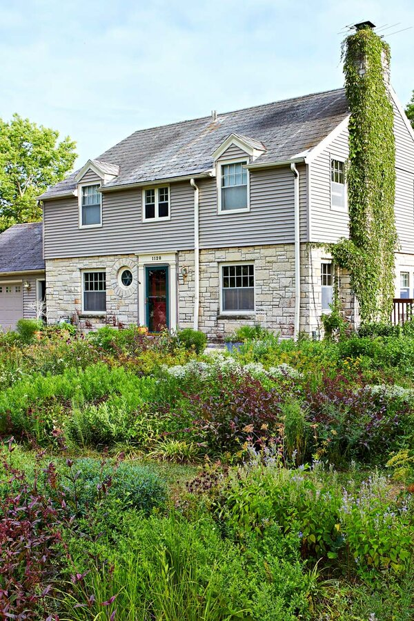 gray home with Midwestern native plants