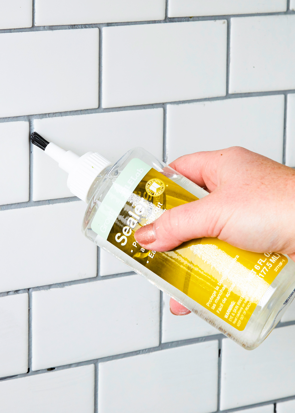 applying sealer to grout