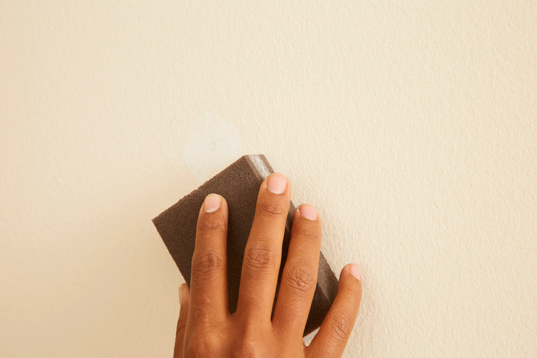 sanding putty on wall