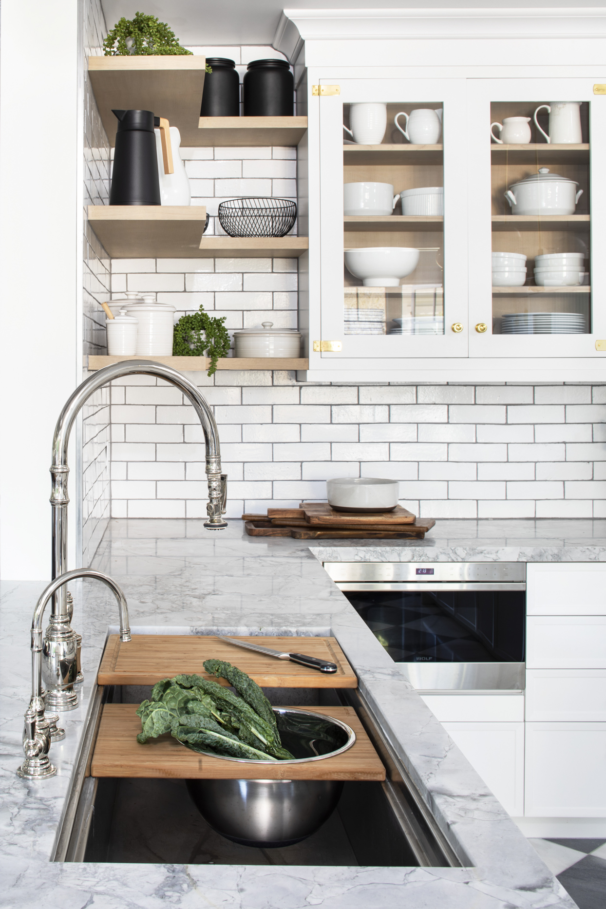 kitchen with marble countertop and subway tile walls