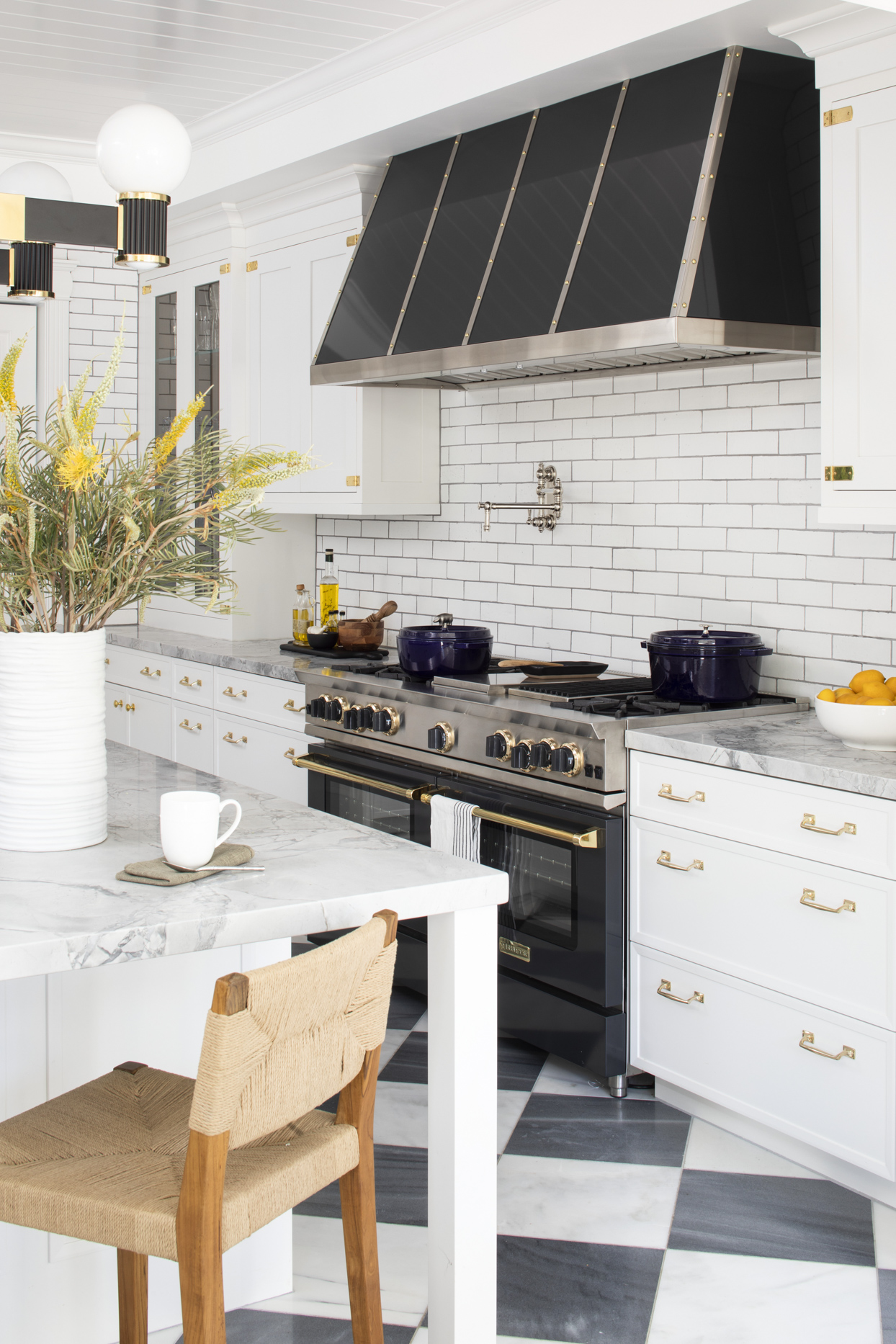 kitchen with marble top table and black appliances