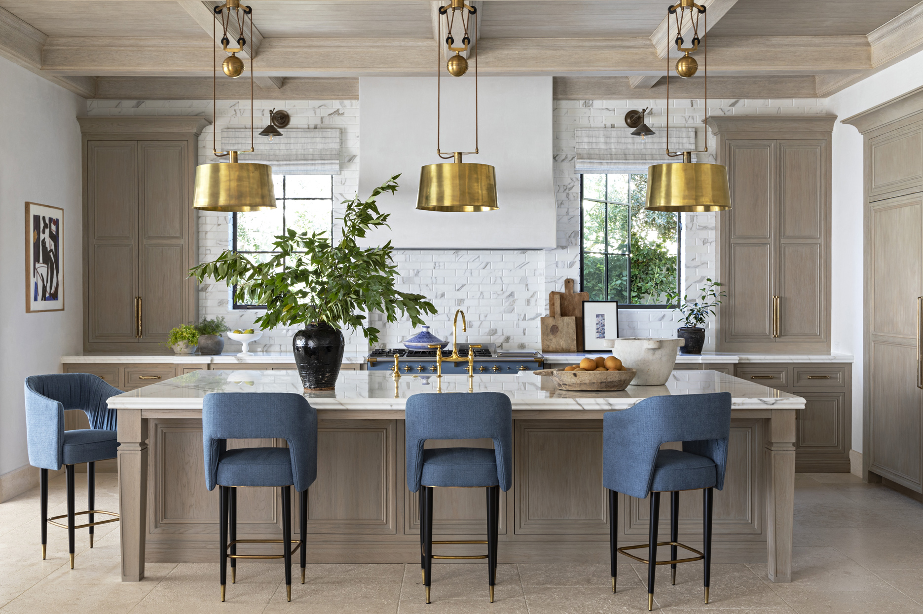 warm tone kitchen with blue and brass accents