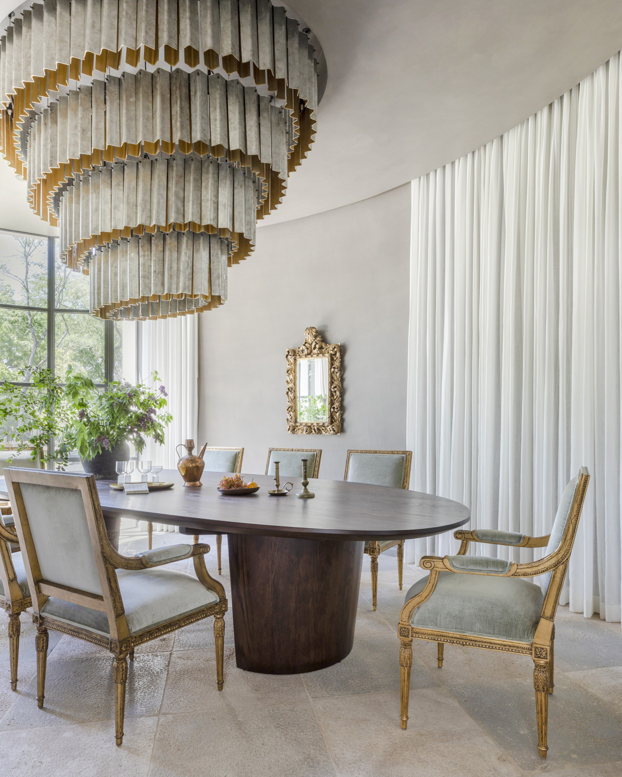 traditional dining room with grand chandelier and gold accents