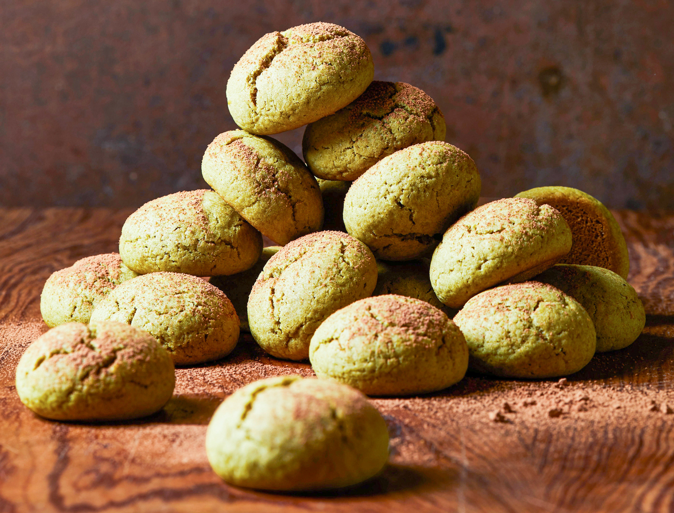 Matcha-Ginger Balls stacked on brown surface