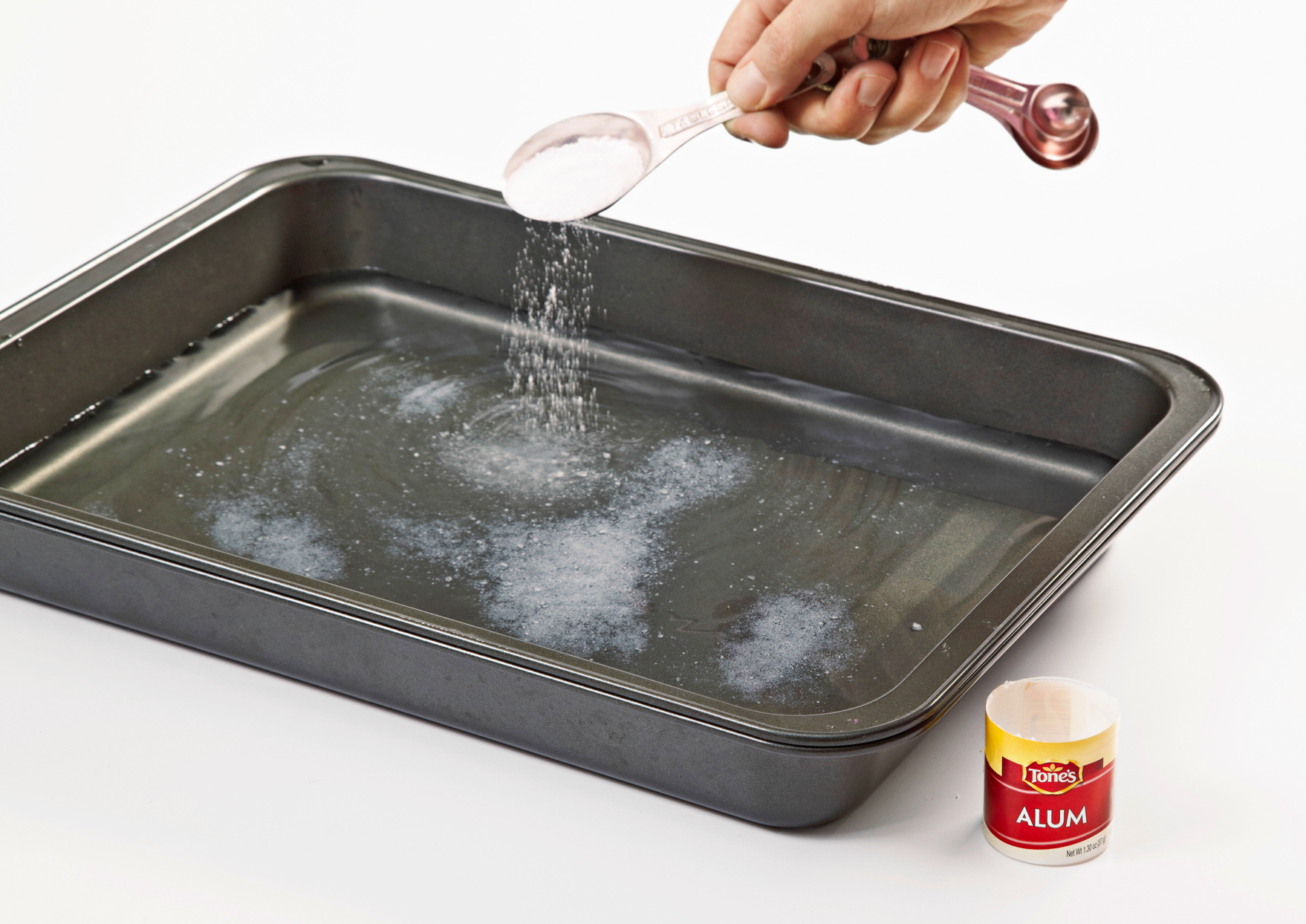 pouring alum into water