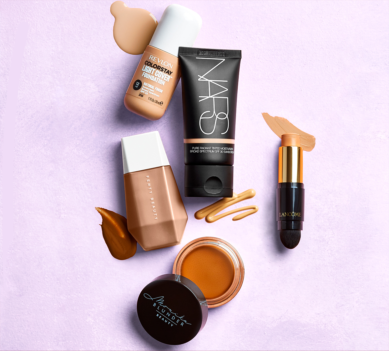 lightweight foundation makeup with color samples abstractly arranged on lavender background