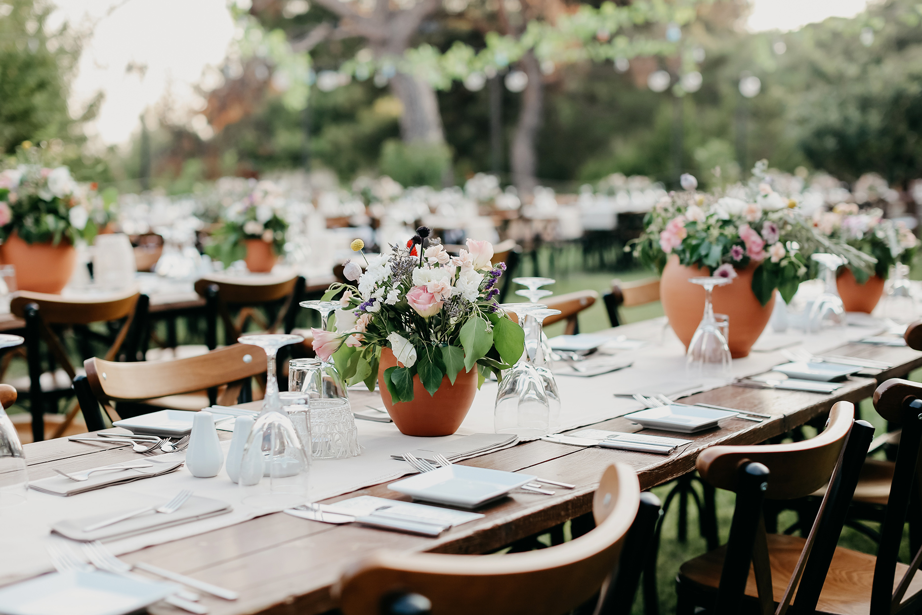 table settings for an outdoor event or reception